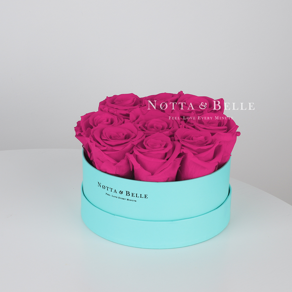 Fuchsia bouquet «Princess» in a turquoise box - 9 roses