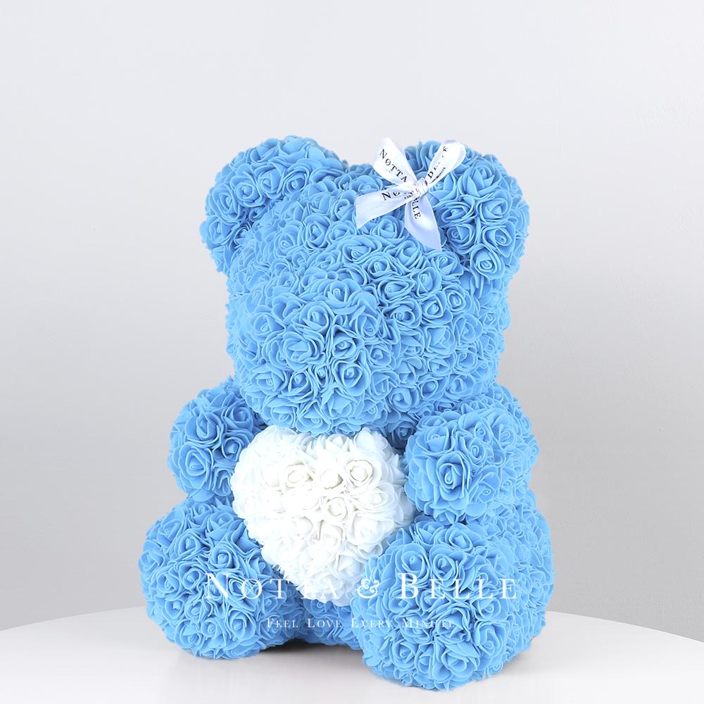 Мишка из роз голубого цвета с белым сердцем - 35 см