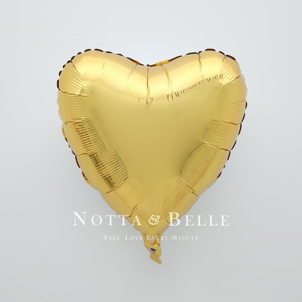 Шарик золотого цвета в виде сердца