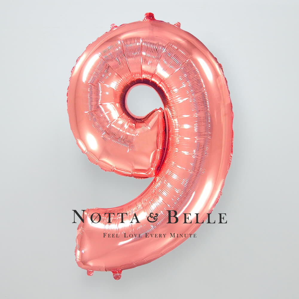 Шарик цвета розового золота в виде цифры 9