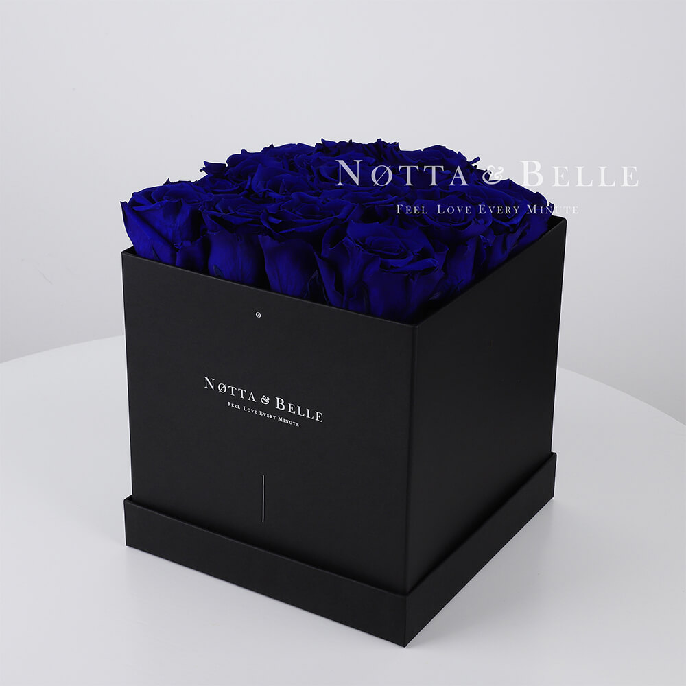 Blue roses in square black box - 17 roses