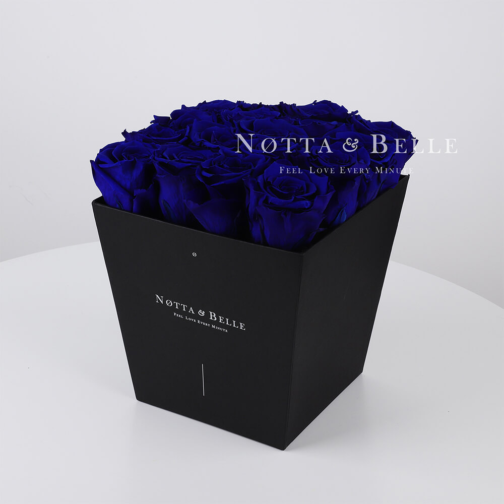 Blue roses in trapezoid black box - 17 roses