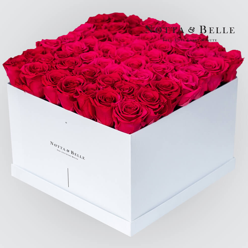 Bright pink roses in a white box - «Romantic» - 49 roses