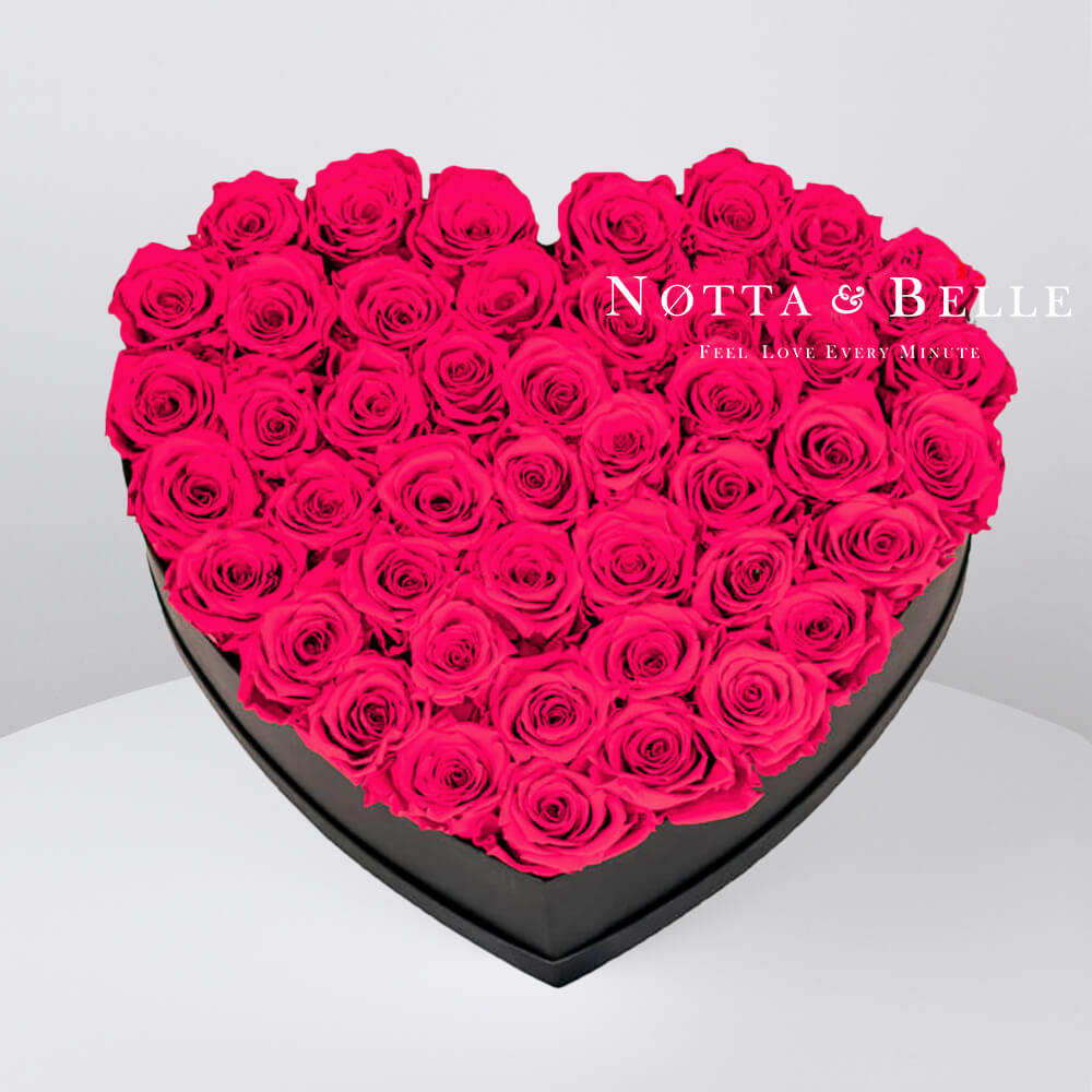 Bright pink roses in heart black box - 35 roses