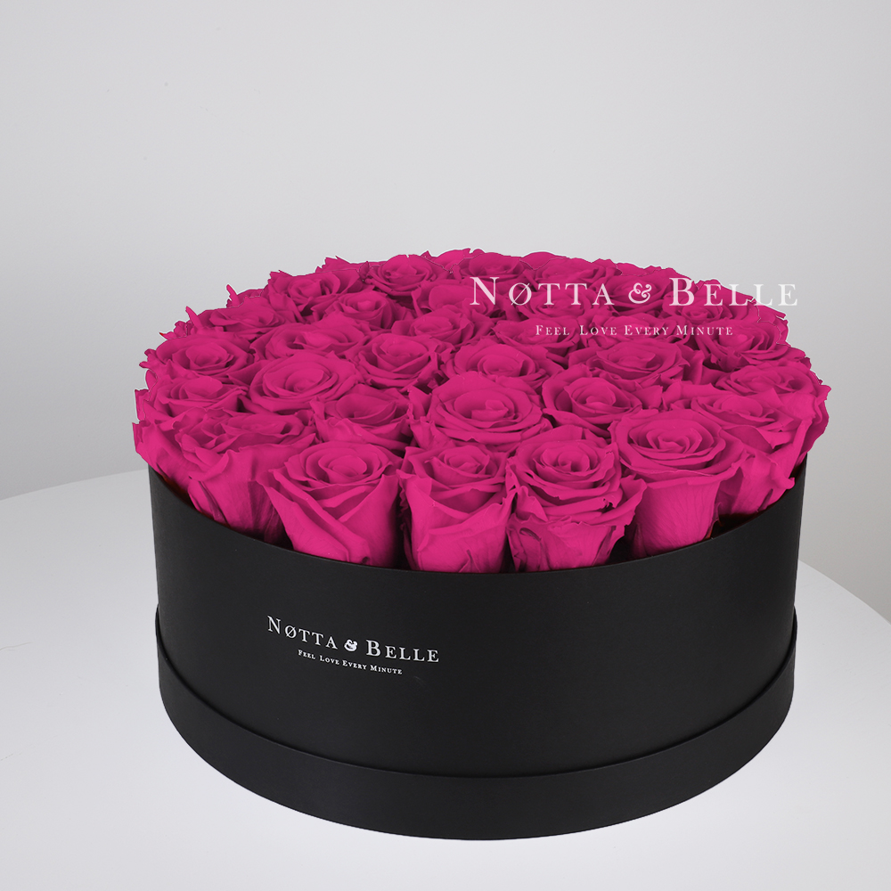Fuchsia roses in round black box - 29 roses