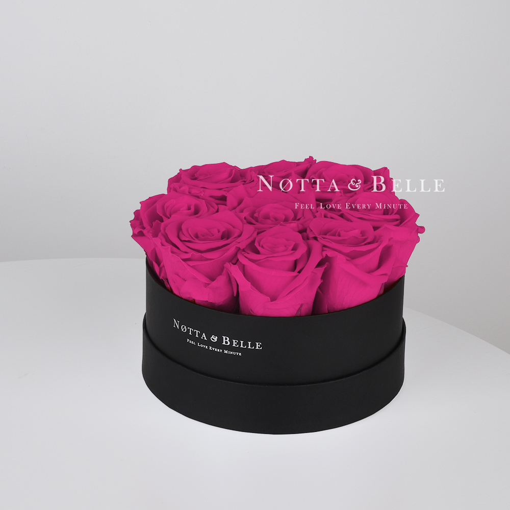 Fuchsia roses in round black box - 9 roses
