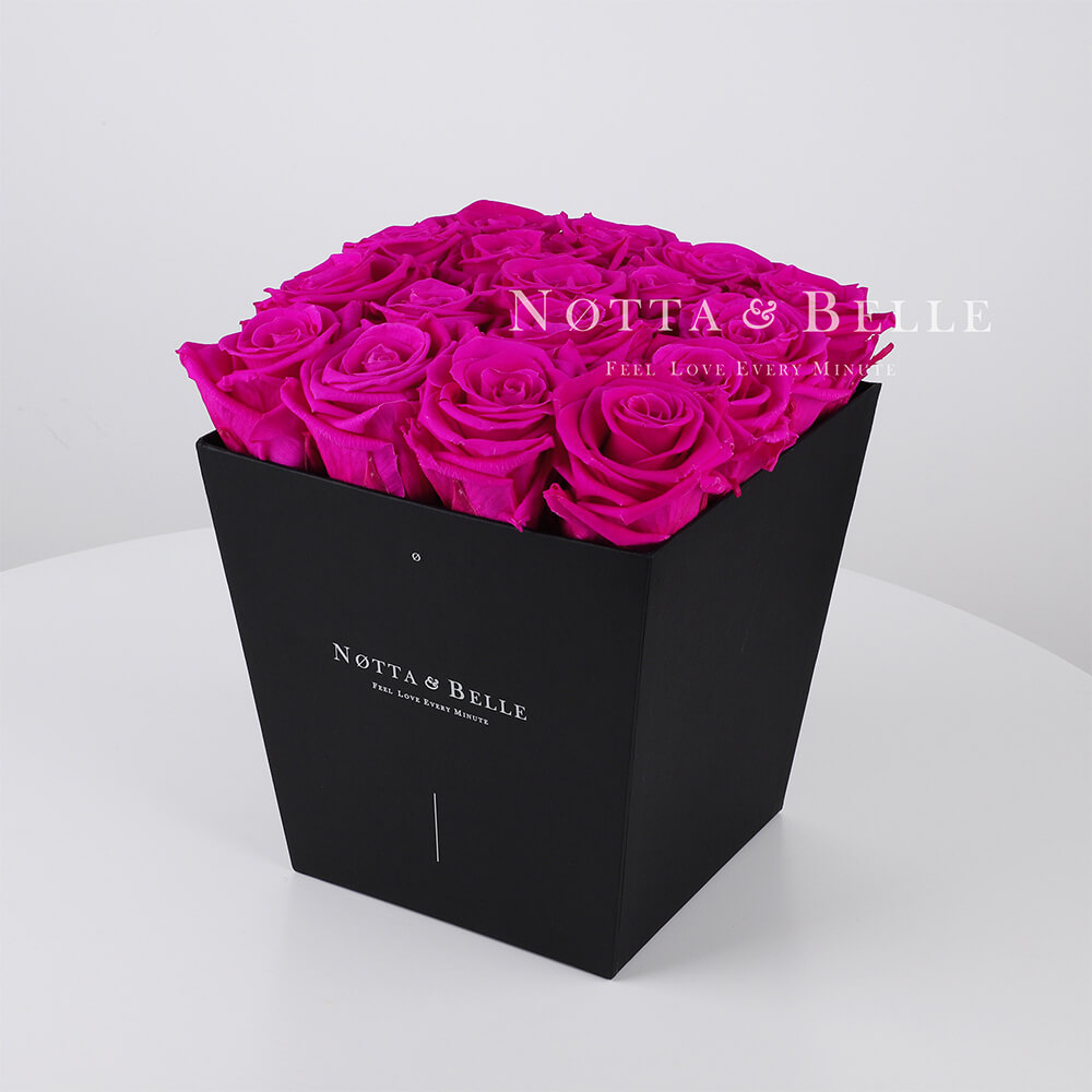Fuchsia roses in trapezoid black box - 17 roses
