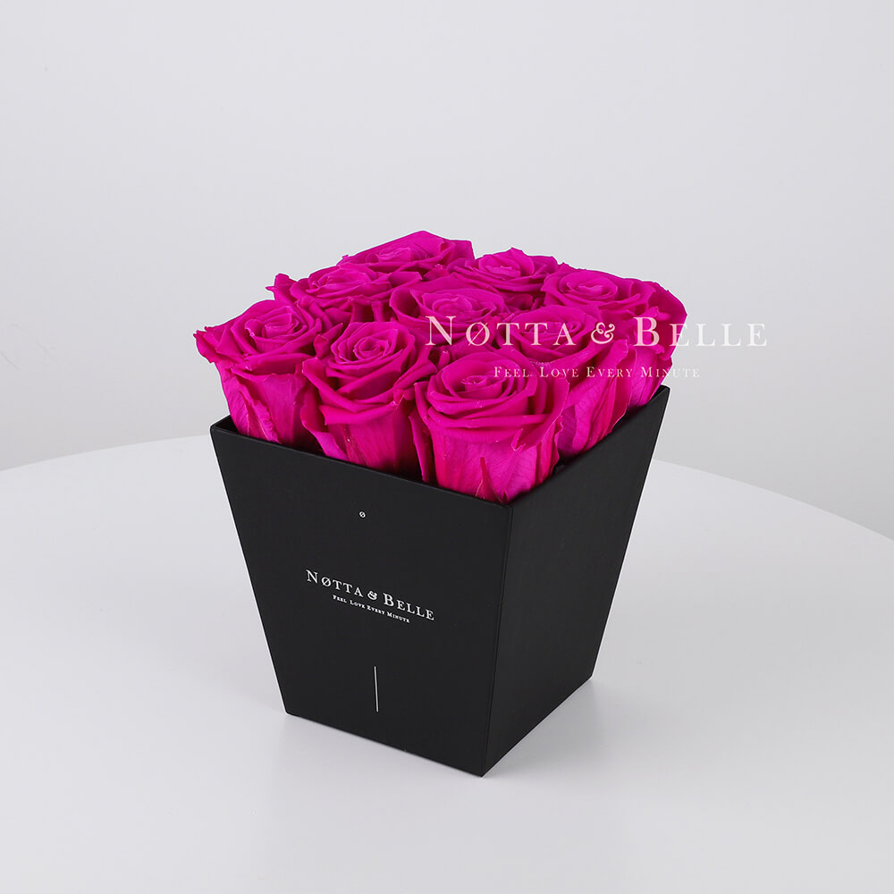 Fuchsia roses in trapezoid black box - 9 roses
