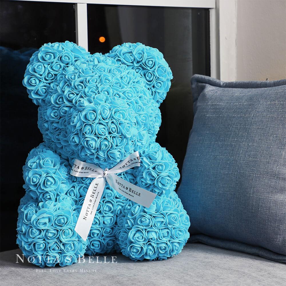 Orsetto di rose colore azzurro 35cm