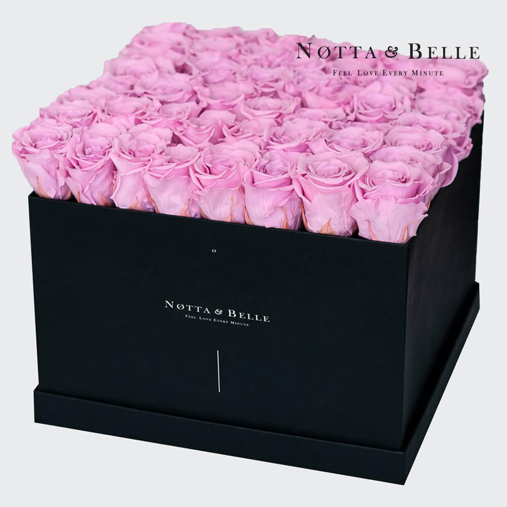 Pink roses in square black box - 49 roses