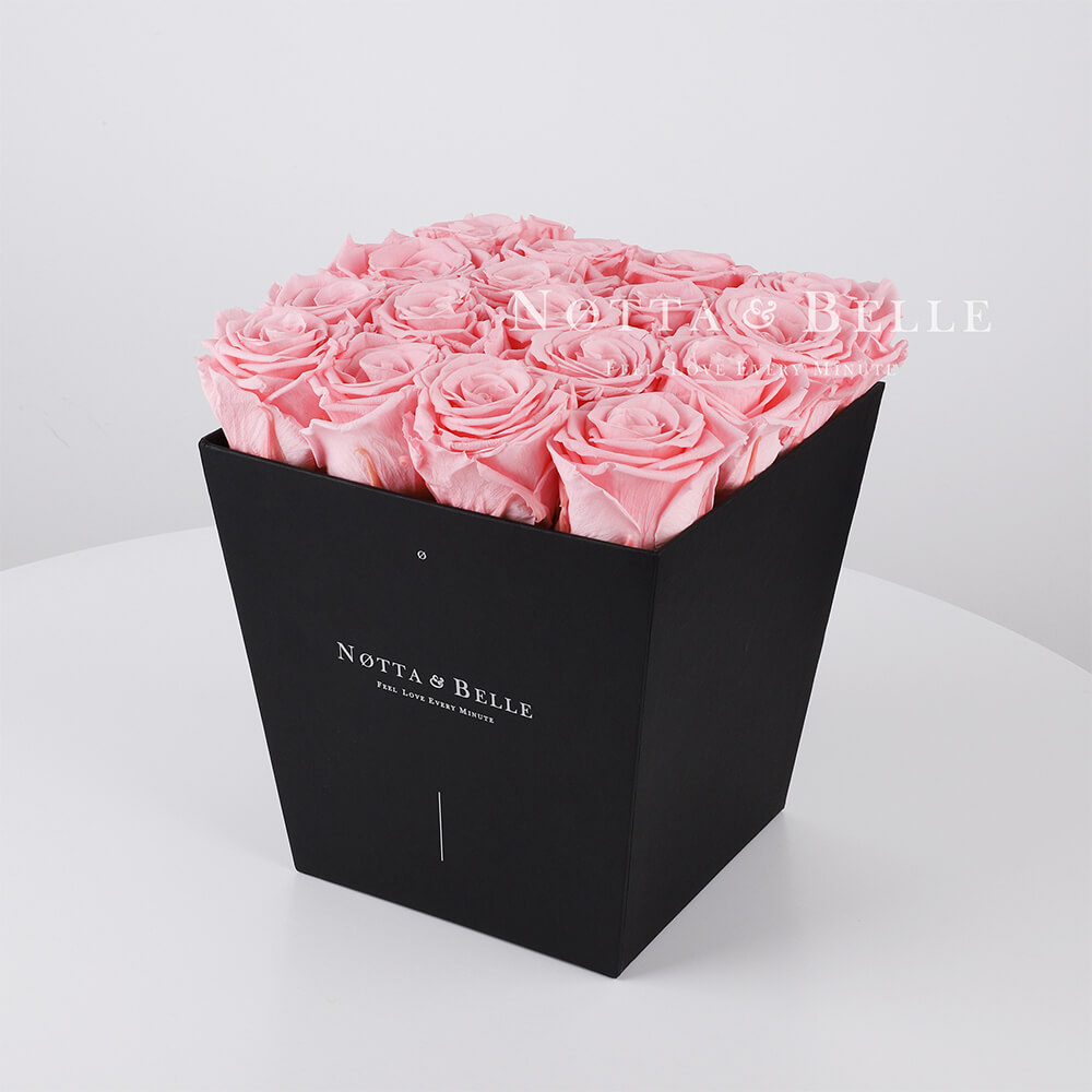 Pink roses in trapezoid black box - 17 roses