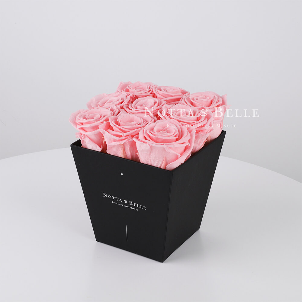 Pink roses in trapezoid black box - 9 roses