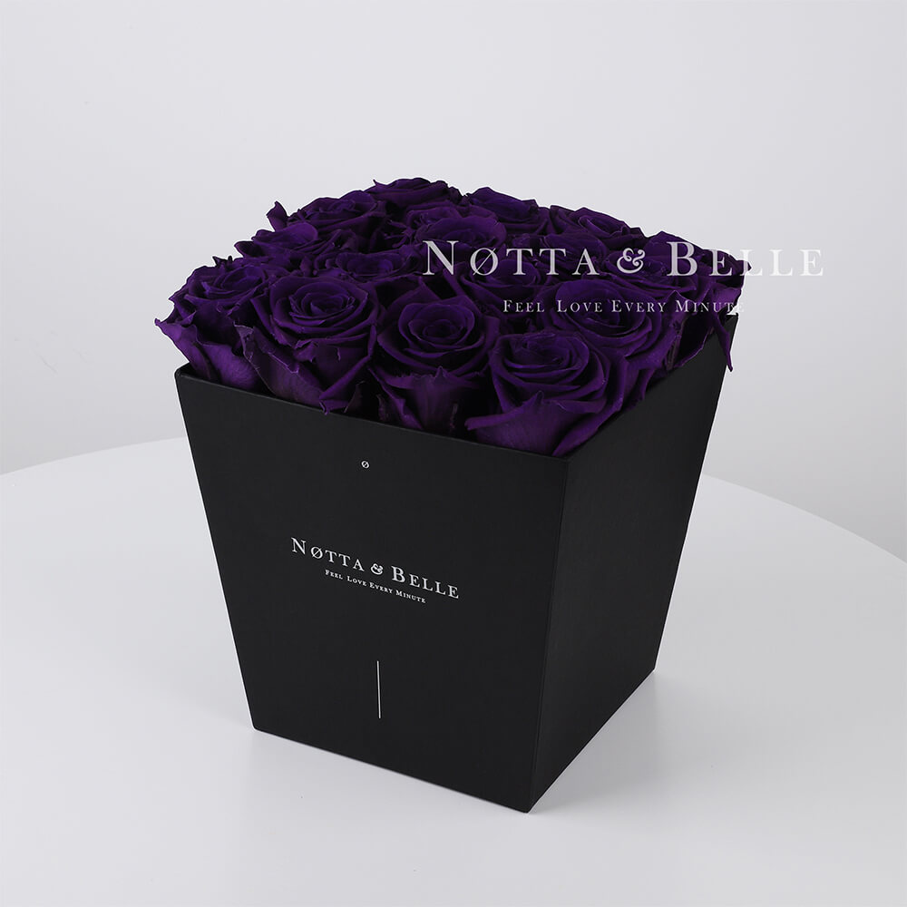 Purple roses in trapezoid black box - 17 roses