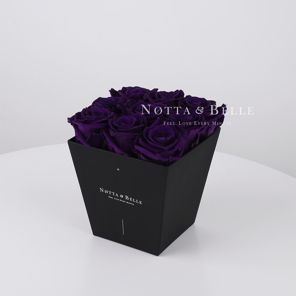 Purple roses in trapezoid black box - 9 roses
