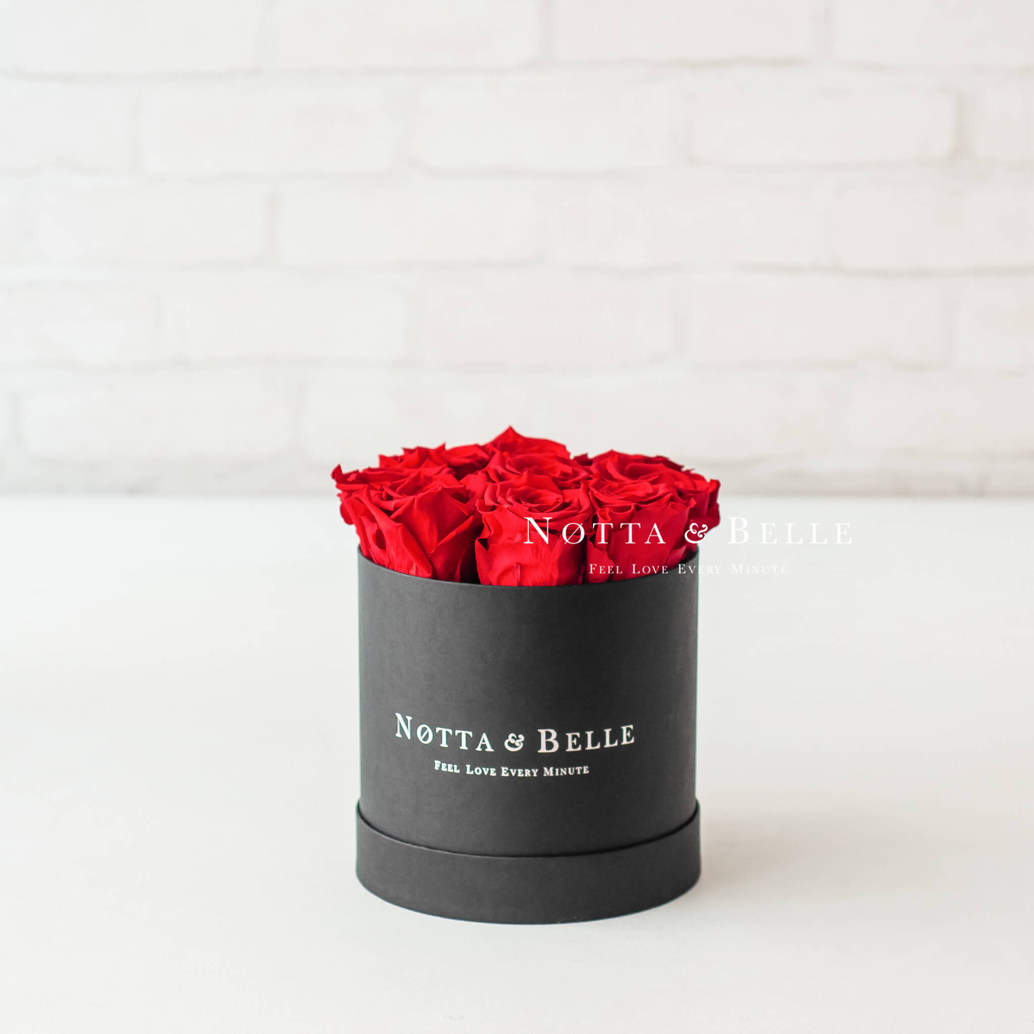 Red roses in round black box - 9 roses