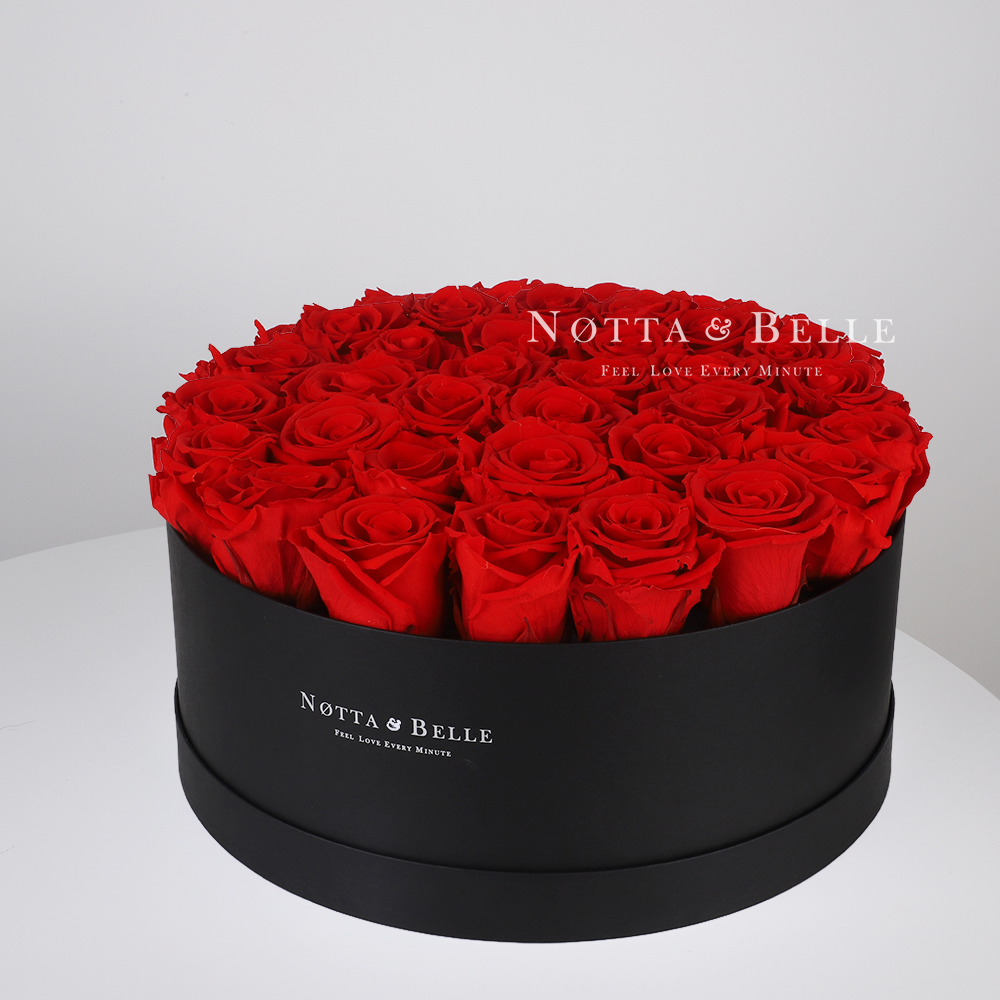 Red roses in round black box - 29 roses