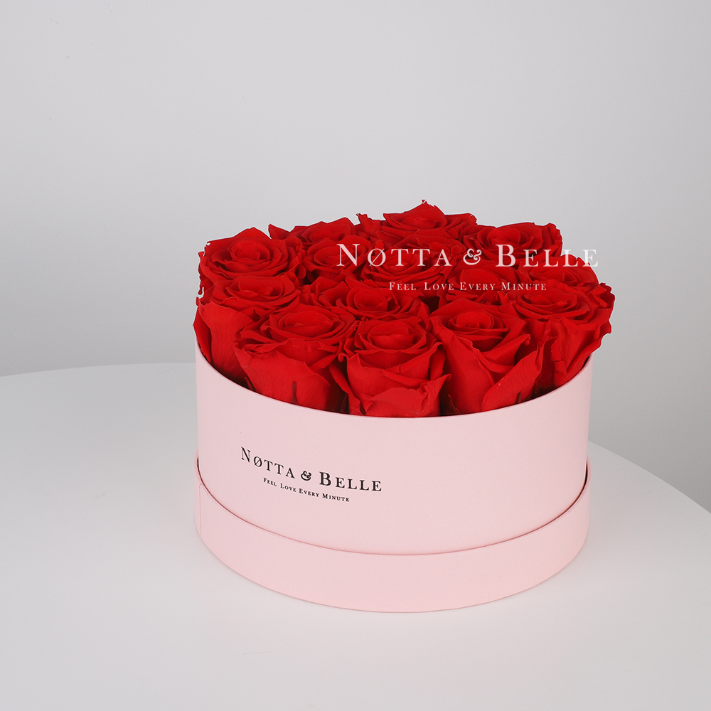 Red roses in round pink box - 15 roses