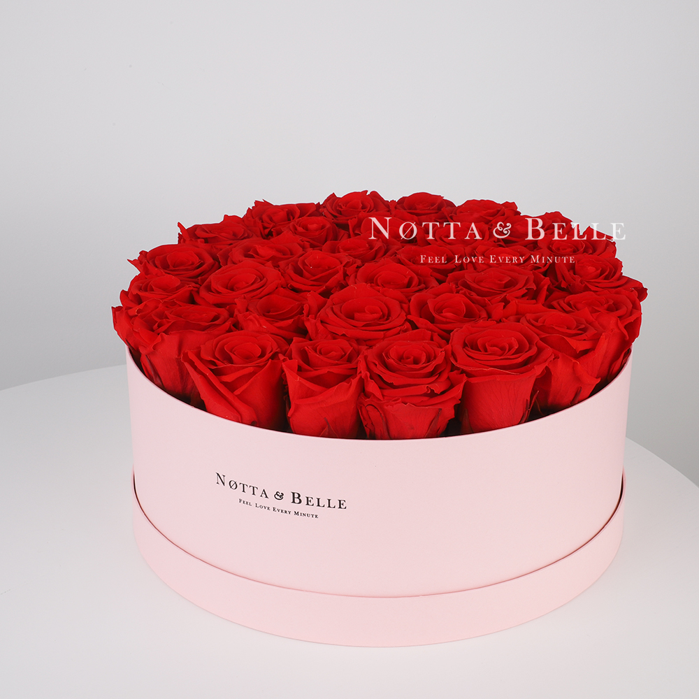 Red roses in round pink box - 29 roses