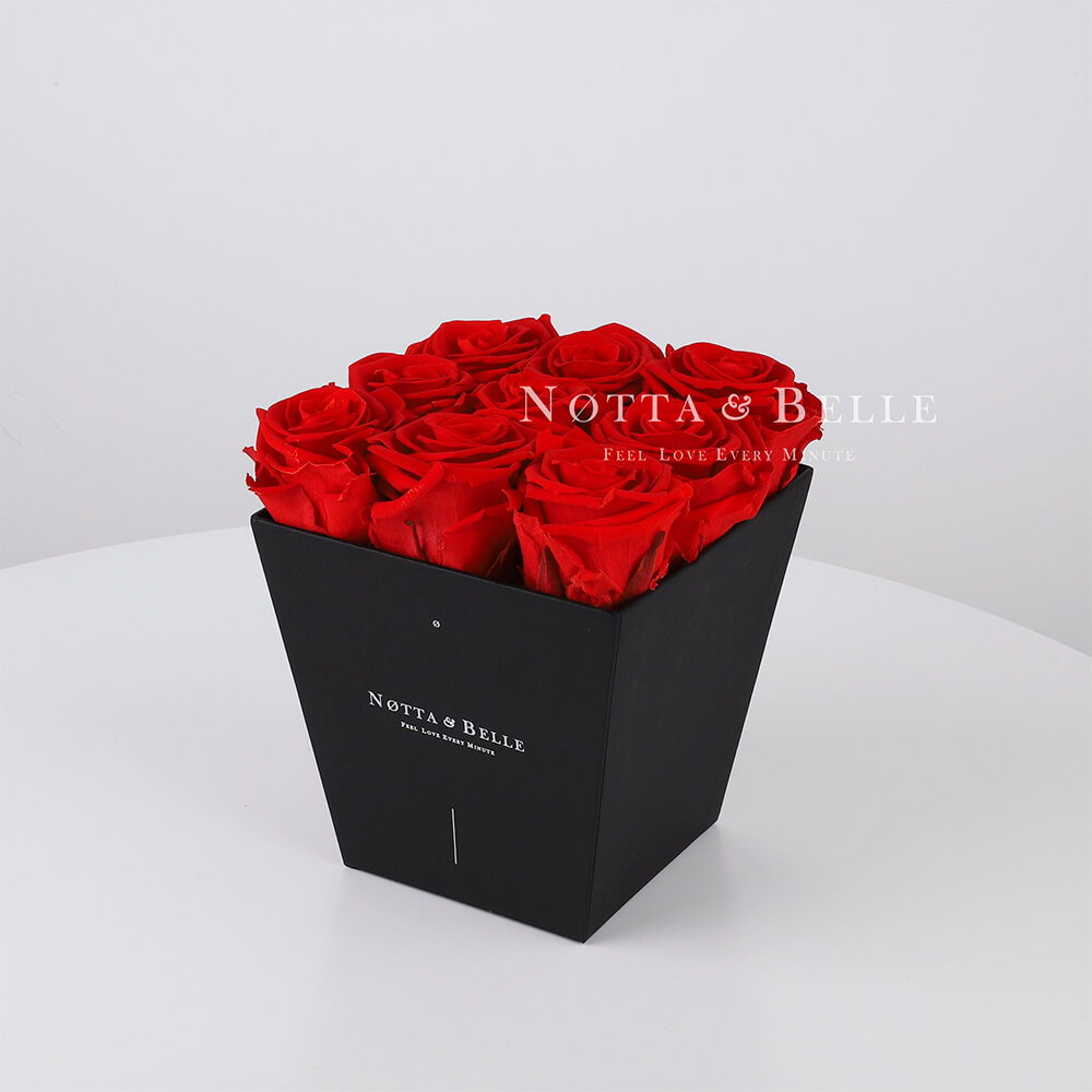 Red roses in trapezoid black box - 9 roses