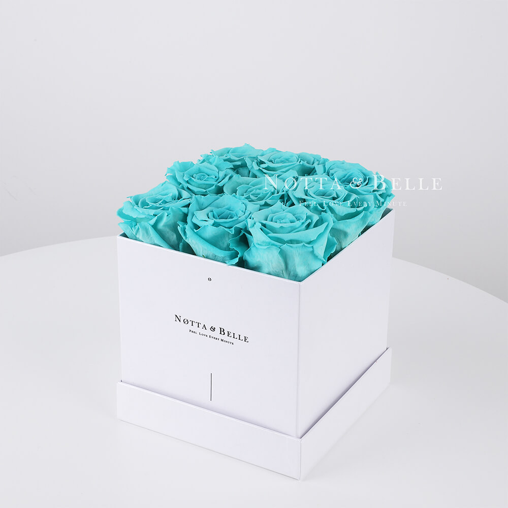 Turquoise roses in a white box - «Romantic» - 9 roses