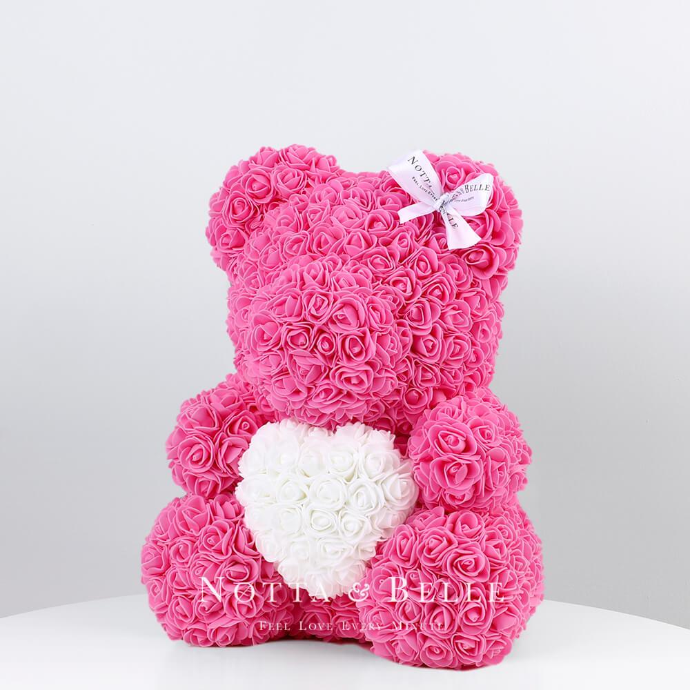 Розовый мишка из роз c белым сердцем - 35 см