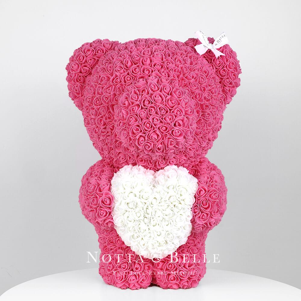 Розовый мишка из роз с белым сердцем - 55 см