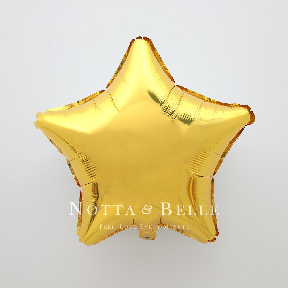 Шарик золотого цвета в виде звезды