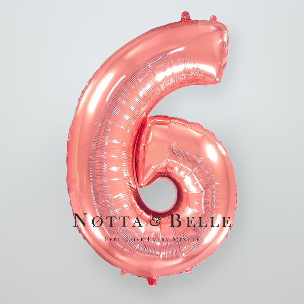 Шарик цвета розового золота в виде цифры 6