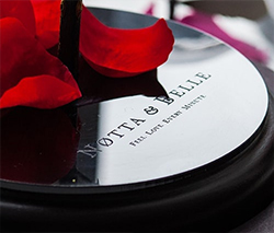 Branded inscription Notta & Belle on the base for rose in glass.
